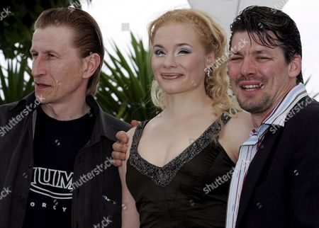 Actress Maria Jarvenhelmi (c) Poses with Actors Ilkka Koivula (l) and Janne Hyytiainen (r) During a Photo Call For the Film 'Laitakaupungin Valot' (lights in the Dusk) by Finnish Director Aki Kaurismaki Running in Competition at the 59th Cannes Film Festival Monday 22 May 2006 in Cannes