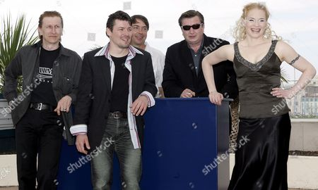 Actress Maria Jarvenhelmi (r) Poses with Actors Ilkka Koivula (l) and Janne Hyytiainen (2nd L) During a Photo Call For the Film 'Laitakaupungin Valot' (lights in the Dusk) by Finnish Director Aki Kaurismaki (2nd R) Running in Competition at the 59th Cannes Film Festival Monday 22 May 2006 in Cannes (person in Center is not Identified )