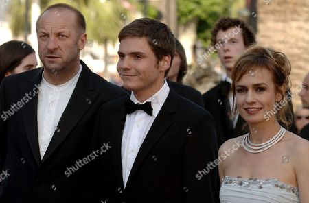 Stock Picture of (l-r) Polish Composer Zbigniew Preisner German Actor Daniel Bruehl and French Actress Sandrine Bonnaire Arrive at the Palais Des Festivals For the Screening of the Film 'Indigenes' by French Director Rachid Bouchareb Running in Competition at the 59th Cannes Film Festival Thursday 25 May 2006 in Cannes