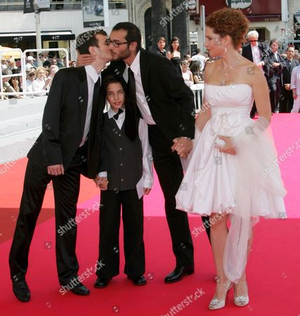 French Director Raphael Nadjari (2-r) Leans Over Israeli Actor Yonathan Alster to Kiss Israeli Actor Michael Moshonov (l) As He Holds Hands with Israeli Actress Limor Goldstein (r) During Arrivals For the Screening of His Film 'Tehilim' Running in Competition at the 60th Cannes Film Festival 20 May 2007 in Cannes France