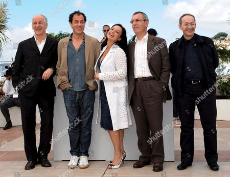 (l-r) Italian Actor Toni Servillo Director Matteo Garrone and Actors Maria Nazionale Gianfelice Imparato and Salvatore Cantalupo Pose For Photographers During a Photocall For Italian Director Matteo Garrone's Film 'Gomorra' Running in Competition at the 61st Edition of the Cannes Film Festival 18 May 2008 in Cannes France