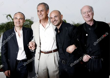 (l-r) French Philippe Val Journalist Managing Editor and Chief Editor of Charlie Hebdo (a Satirical Political Weekly Newspaper) Director Daniel Leconte Richard Malka Lawyer of Charlie Hebdo and Cartoonist Wolinski Pose During a Photocall For Their Film 'It's Hard Being Loved by Jerks' at the 61st Edition of the Cannes Film Festival in Cannes France 16 May 2008