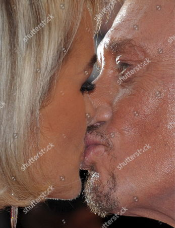 French Rockstar Johnny Hallyday and His Wife Laetitia Kiss As They Arrive For the Gala Screening of the Film 'Vengeance' by Johnny to Running in Competition During the 62nd Edition of the Cannes Film Festival in Cannes France 17 May 2009