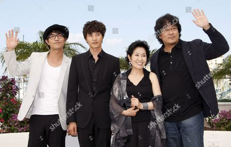 Korean Actors Jin Goo and Won Bin Actress Kim Hye-ja and Director Bong Joon Ho Attend a Photocall For the South Korean Film 'Mother' by Bong Joon-ho Running in the 'Un Certain Regard Category' During the 62nd Edition of the Cannes Film Festival in Cannes France 16 May 2009
