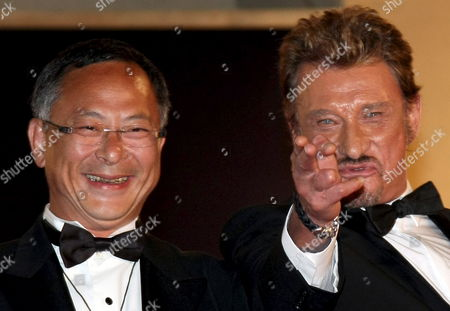 French Rockstar Johnny Hallyday (r) and Director Johnny to (l) Leave the Gala Screening of Their Film 'Vengeance' by Johnny to Running in Competition During the 62nd Edition of the Cannes Film Festival in Cannes France 17 May 2009