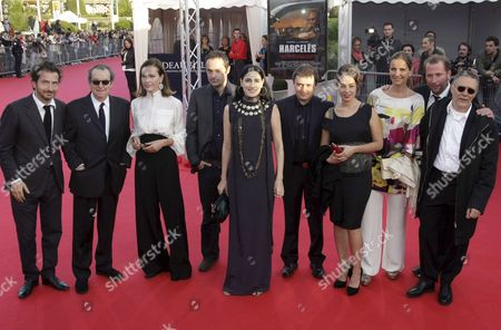 Stock Photo of The Full Jury of the 34th International Film Festival of Deauville From (l-r) : French Director Edouard Baer Us Production Designer Dean Tavoularis French Actress and President Carole Bouquet French Director Ceric Kahn Israeli Director Ronit Elkabetz Romanian Director Christian Mungiu French-italian Actress Diane Fleri Portuguese Actress Leonor Silveira Belgian Humorist and Actor Francois Damiens and French Director and Screenwritter Pierre Jolivet Pose On the Red Carpet As They Arrives For the Screening of 'Lakeview Terrasse' During the 34th International Film Festival of Deauville 07 September 2008 in Deauville France the Festival is Scheduled For 05 to 14 September