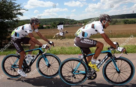 Ag2r Riders Jose Luis Arrieta of Spain (l) and Cyril Dessel of France (r) Cycle Past a Horseman During the 12th Stage of the Tour De France Cycling Race Between Tonnerre and Vittel France 16 July 2009