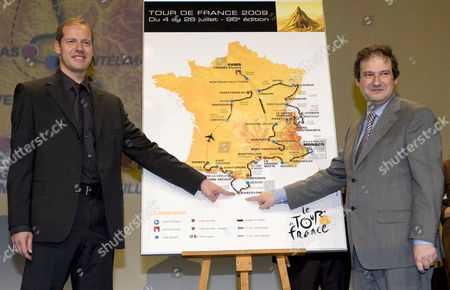 General Director of the Tour De France Cycling Race Christian Prudhomme (l) and Mayor of Barcelona Jordi Hereu (r) Shake Hands During the Presentation of the Tour De France 2009 in Paris France On 22 October 2008 the Race Will Start On 04 July 2009 in Monaco and End On 26 July in Paris