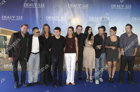 Stock Image of The Jury of the 34th International Film Festival of Deauville (l-r) : Belgian Humorist and Actor Francois Damiens French Screenwritter Pierre Jolivet Portuguese Actress Leonor Silveira Romanian Director Christian Mungiu French Actress and President of the Jury Carole Bouquet Us Production Designer Dean Tavoularis Israeli Director Ronit Elkabetz French Director Edouard Baer French-italian Actress Diane Fleri and French Director Ceric Kahn Pose For Photographers During the Jury's Photocall at the 34th International Film Festival of Deauville 08 September 2008 in Deauville France the Festival is Scheduled For 05 to 14 September