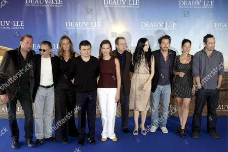 Stock Picture of The Jury of the 34th International Film Festival of Deauville (l-r) : Belgian Humorist and Actor Francois Damiens French Screenwritter Pierre Jolivet Portuguese Actress Leonor Silveira Romanian Director Christian Mungiu French Actress and President of the Jury Carole Bouquet Us Production Designer Dean Tavoularis Israeli Director Ronit Elkabetz French Director Edouard Baer French-italian Actress Diane Fleri and French Director Ceric Kahn Pose For Photographers During the Jury's Photocall at the 34th International Film Festival of Deauville 08 September 2008 in Deauville France the Festival is Scheduled For 05 to 14 September