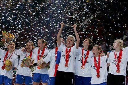 Russia's Team Captain Inna Suslina Hoists the Trophy As the Team Celebrate the Victory Against Norway's During Their Women's Handball World Championship Final Match in Paris France 16 December 2007 Russia Won 29-24 and Became the Champion