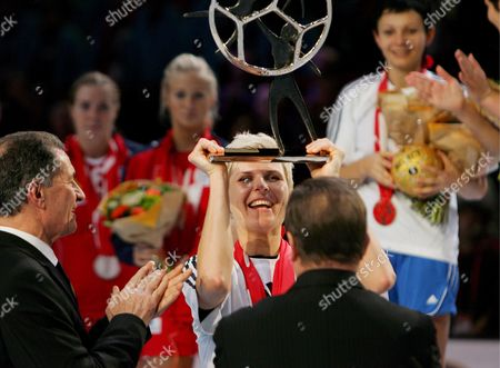 Russia's Team Captain Inna Suslina Receives and Hoists the Trophy After Their Victory Against Norway During Their Women's Handball World Championship Final Match in Paris France 16 December 2007 Russia Won 29-24 and Became the Champion