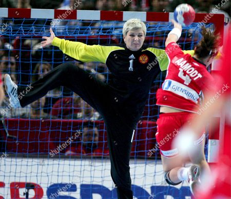 Russia's Goalie Inna Suslina Covers Against Norway's Ragnhild Aamodt During Their Women's Handball World Championship Final Match in Paris France 16 December 2007 Russia Won 29-24 and Became the Champion Suslina Received the Award to the Best Player