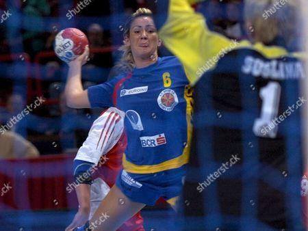 Romania's Camelia Balint Scores Against Russia's Inna Suslina During Their Women's Handball World Championship Semi Finals Match in Paris France 15 December 2007