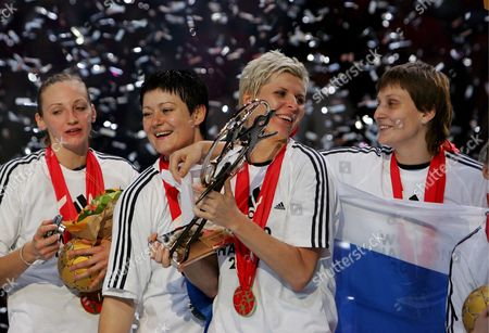 Russia's Team Captain Inna Suslina Holds the Trophy As the Team Celebrate the Victory Against Norway's During Their Women's Handball World Championship Final Match in Paris France 16 December 2007 Russia Won 29-24 and Became the Champion