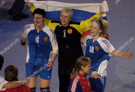 Russia's Players Anna Kareeva Inna Suslina (elected Best Player) and Nadezhda Muravyeva Clebrate the Team's Victory Against Norway's During Their Women's Handball World Championship Final Match in Paris France 16 December 2007 Russia Won 29-24 and Became the Champion