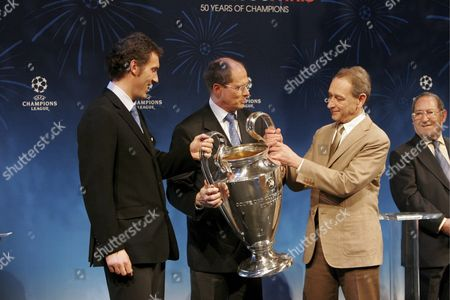 (l to R) French Soccer Player Laurent Blanc Uefa Chief Executive Lars-christer Olsson Paris Mayor Bertrand Delanoe and Looking On Former Spanish Soccer Player Francisco Gento As the New Uefa Champions League Trophy is Unveiled in Paris On Friday 10 March 2006 the Trophy Will Be Awarded to the Winner of the Champions League Final to Be Payed in Paris On May 17
