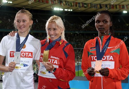 (l-r) Yuliya Zarudneva (russia Silver) Marta Dominguez (spain Gold) and Milcah Chemos Cheywa (kenya Bronze) Pose During the Medal Ceremony of the 3000m Steeplechase at the 12th Iaaf World Championships in Athletics Berlin Germany 17 August 2009 Germany Berlin