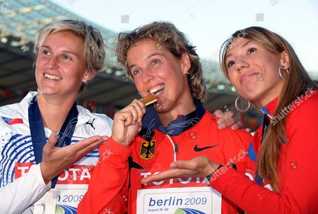 L-r) Barbora Spotakova (czech Republic Silver) Steffi Nerius (germany Gold) and Maria Abakumova (russia Bronze) Pose During the Medal Ceremony For the Women's Javelin at the 12th Iaaf World Championships in Athletics Berlin Germany 19 August 2009 Germany Berlin