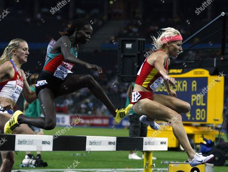 Spanish Marta Dominguez (r) Competes in the 3000m Steeplechase Final at the 12th Iaaf World Championships in Athletics Berlin Germany 17 August 2009 Left is Yuliya Zarudneva of Russia Center is Gladys Jerotich Kipkemoi (kenya)