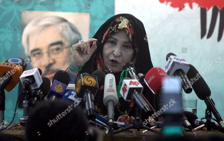 Zahra Rahnavard Wife of Iranian Presidential Hopeful Mir-hossein Mousavi Speaks Next to a Picture of Her Husband During a Press Conference in Tehran Iran 7 June 2009 Rahnavard Was Accused by Iranian President Mahmoud Ahmadinejad of Exposing Herself As Phd Graduate Although She Had No Doctorate Rahnavard a Renowned Woman Activist and University Professor Said That the President Should Either Apologize Or She Would Sue Him in Court Moussavi is the Main Challenger of Ahmadinejad and Accused the President to Have in the Last Four Years Humiliated the Iranians Before the World