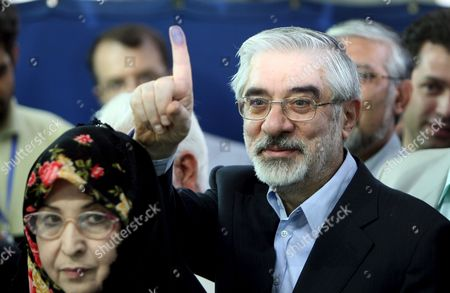 Iranian Presidential Candidate Mir-hossein Moussavi (r) Shows His Finger As He Stands Next to His Wife Zahra Rahnavard (l) After He Cast His Vote at a Polling Station at the Ershad Mosque in Southern Tehran Iran 12 June 2009 Moussavi is the Main Challenger of Incumbent President Mahmoud Ahmadinejad in Presidential Election More Than 46 Million Iranians Are Eligible to Vote and a Record Turnout is Expected to Be Reached the Four Candidates Are Incumbent President Ahmadinejad Former Prime Minister Mir-hossein Moussavi Former Parliament Speaker Mehdi Karrubi and Former Revolutionary Guards Commander Mohsen Rezaie