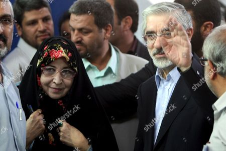 Iranian Presidential Candidate Mir-hossein Moussavi (r) and His Wife Zahra Rahnavard (l) at a Polling Station at the Ershad Mosque in Southern of Tehran Iran 12 June 2009 More Than 46 Million Iranians Are Eligible to Vote and a Record Turnout is Expected to Be Reached the Four Candidates Are Incumbent President Ahmadinejad Former Prime Minister Mir-hossein Moussavi Former Parliament Speaker Mehdi Karrubi and Former Revolutionary Guards Commander Mohsen Rezaie