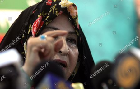 Zahra Rahnavard Wife of Iranian Presidential Hopeful Mir-hossein Mousavi Speaks Next to a Picture of Her Husband During a Press Conference in Tehran Iran 7 June 2009 Rahnavard was Accused by Iranian President Mahmoud Ahmadinejad of Exposing Herself As Phd Graduate Although She Had No Doctorate Rahnavard a Renowned Woman Activist and University Professor Said That the President Should Either Apologize Or She Would Sue Him in Court Moussavi is the Main Challenger of Ahmadinejad and Accused the President to Have in the Last Four Years Humiliated the Iranians Before the World Iran (islamic Republic Of) Tehran