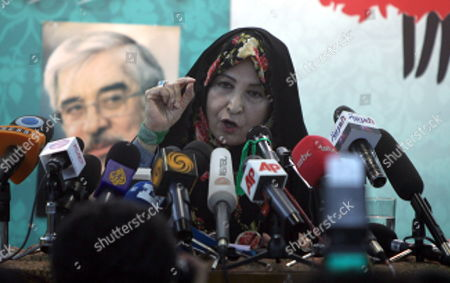 Zahra Rahnavard Wife of Iranian Presidential Hopeful Mir-hossein Mousavi Speaks Next to a Picture of Her Husband During a Press Conference in Tehran Iran 7 June 2009 Rahnavard was Accused by Iranian President Mahmoud Ahmadinejad of Exposing Herself As Phd Graduate Although She Had No Doctorate Rahnavard a Renowned Woman Activist and University Professor Said That the President Should Either Apologize Or She Would Sue Him in Court Moussavi is the Main Challenger of Ahmadinejad and Accused the President to Have in the Last Four Years Humiliated the Iranians Before the World Iran (islamic Republic Of) Karaj