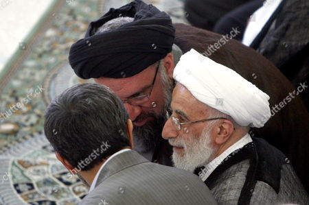 Iranian Ayatollah Ahmad Khatami (r) Guardian Council Head Ayatollah Ahmad Janati (c) and Iranian President Mahmoud Ahmadinejad (l) Whisper to Each Other During the Friday Prayer Ceremony in Tehran Iran August 28 2009 Ahmadinejad Called For Prosecuting the Countrys Opposition Leaders For Leading the Protests Against Alleged Fraud in the June 12 Presidential Elections Ahmadinejad Was Referring to Defeated Presidential Candidates Former Premier Mir-hossein Moussavi and Former Parliamentary Speaker Mehdi Karroubi As Well As Former Presidents Akbar Hashemi-rafsanjani and Mohammad Khatami Who Are the Main Leaders of the Opposition