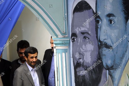 Iranian President Mahmoud Ahmadinejad (l) Walks Past Images Depicting Former Iranian President Mohammad Ali Rajaie (r) and Former Iranian Prime Minister Mohammad Javad Bahonar (r-2) As He Arrives to Attend a Friday Prayer Ceremony Tehran Iran 28 August 2009 Behind Ahmedinejad Are Portraits of Iran's Supreme Leader Ayatollah Ali Khamenei (r) and the Late Supreme Leader of the 1979 Islamic Revolution Grand Ayatollah Ruhollah Khomeini (l) Ahmadinejad Was Referring to Defeated Presidential Candidates Former Premier Mir-hossein Moussavi and Former Parliamentary Speaker Mehdi Karroubi As Well As Former Presidents Akbar Hashemi-rafsanjani and Mohammad Khatami Who Are the Main Leaders of the Opposition Opposition Supporters Who Have not Yet Acknowledged Ahmadinejads Re-election Have Staged Street Demonstrations Against Ahmadinejad Protesting the Alleged Vote Rigging in Favour of the Incumbent the Crowd at the Prayer Ceremony Approved Ahmadinejads Demand Shouting 'The Leaders of the Unrests Should Be Executed'