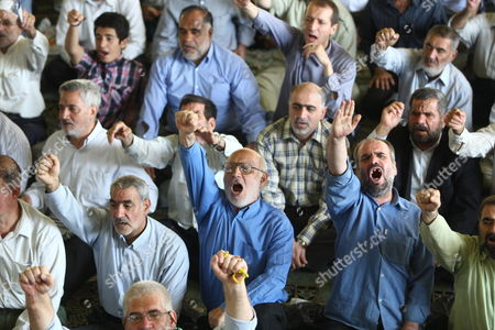 Iranian Worshipers Shouting 'The Leaders of the Unrests Should Be Executed' During the Friday Prayer Ceremony Tehran Iran 28 August 2009 Ahmadinejad Called For Prosecuting the Country's Opposition Leaders For Leading the Protests Against Alleged Fraud in the 12 June Presidential Elections Ahmadinejad Was Referring to Defeated Presidential Candidates Former Premier Mir-hossein Moussavi and Former Parliamentary Speaker Mehdi Karroubi As Well As Former Presidents Akbar Hashemi-rafsanjani and Mohammad Khatami Who Are the Main Leaders of the Opposition Opposition Supporters Who Have not Yet Acknowledged Ahmadinejad's Re-election Have Staged Street Demonstrations Against Ahmadinejad Protesting the Alleged Vote Rigging in Favor of the Incumbent the Crowd at the Prayer Ceremony Approved Ahmadinejad's Demand Shouting 'The Leaders of the Unrests Should Be Executed'