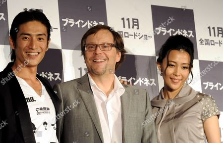 Academy Award-nominated Brazilian Film Director Fernando Meirelles (c) Appears with Japanese Actress Yoshino Kimura (r) and Actor Yusuke Iseya to Promote Their Latest Movie Blindness Before the Press in Tokyo 14 August 2008 the Film Will Premiere in Japan in November Blindness is a Dramatic Thriller Film That is an Adaptation of the 1995 Novel of the Same Name by Nobel-laureate Portuguese Writer Jose Saramago About a Society Suffering an Epidemic of Blindness
