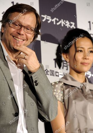 Academy Award-nominated Brazilian Film Director Fernando Meirelles (l) with Japanese Actress Yoshino Kimura Appear Before the Media in Tokyo Japan to Promote Their Latest Movie Blindness 14 August 2008 the Film Will Premiere in Japan in November Blindness is a Dramatic Thriller Film That is an Adaptation of the 1995 Novel of the Same Name by Nobel-laureate Portuguese Writer Jose Saramago About a Society Suffering an Epidemic of Blindness