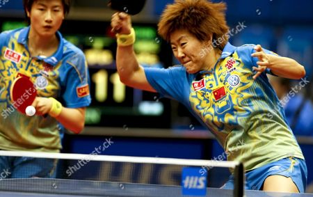 Guo Yan (r) of China Hits a Forehand Return As Her Partner Ding Ning (l) Looks On During Their Women's Doubles Semifinal Match Against South Korea's Kim Kyung Ah and Park Mi Young at the World Table Tennis Championships in Yokohama South of Tokyo Japan 04 May 2009