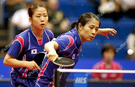 Kim Kyung Ah of South Korea (r) Hits a Backhand Return As Her Partner Park Mi Young (l) Looks On During Their Women's Doubles Quarter Final Match Against Hong Kong's Lin Ling and Zhang Rui at the World Table Tennis Championships in Yokohama South of Tokyo Japan 03 May 2009