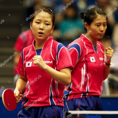 Park Mi Young (l) and Kim Kyung Ah (r) of South Korea Reacts After Scoring a Point During Their Women's Doubles Third Round Match Against Li Qianbing and Liu Jia of Austria at the World Table Tennis Championships in Yokohama South of Tokyo Japan 02 May 2009