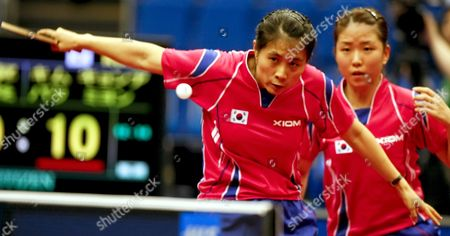 Kim Kyung Ah (l) of South Korea Hits a Backhand Return As Her Partner Park Mi Young (r) Looks On During Their Women's Doubles Semi Final Match Against China's Ding Ning and Guo Yan at the World Table Tennis Championships in Yokohama South of Tokyo Japan 04 May 2009
