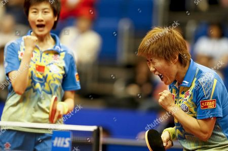 Guo Yan (r) and Ding Ning (l) of China React After Scoring a Point During Their Women's Doubles Semifinal Match Against South Korea's Kim Kyung Ah and Park Mi Young at the World Table Tennis Championships in Yokohama South of Tokyo Japan 04 May 2009