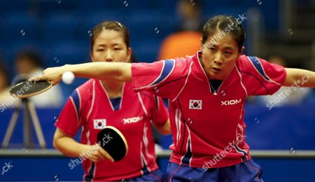 Kim Kyung Ah (r) of South Korea Hits a Backhand Return As Her Partner Park Mi Young (l) Looks On During Their Women's Doubles Third Round Match Against Li Qianbing and Liu Jia of Austria at the World Table Tennis Championships in Yokohama South of Tokyo Japan 02 May 2009