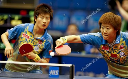 Guo Yan (r) of China Hits a Forehand Return As Her Partner Ding Ning (l) Looks On During Their Women's Doubles Semi Final Match Against South Korea's Kim Kyung Ah and Park Mi Young at the World Table Tennis Championships in Yokohama South of Tokyo Japan 04 May 2009