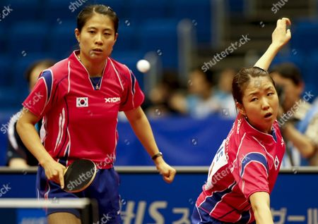 Park Mi Young (r) of South Korea Hits a Backhand Return As Her Partner Kim Kyung Ah (l) Looks On During Their Women's Doubles Third Round Match Against Li Qianbing and Liu Jia of Austria at the World Table Tennis Championships in Yokohama South of Tokyo Japan 02 May 2009