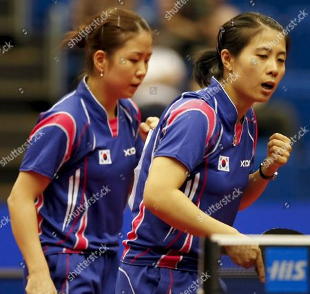 Kim Kyung Ah (r) and Park Mi Young (l) of South Korea Reacts After Scoring a Point During Their Women's Doubles Quarter Final Match Against Hong Kong's Lin Ling and Zhang Rui at the World Table Tennis Championships in Yokohama South of Tokyo Japan 03 May 2009