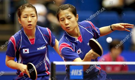 Kim Kyung Ah of South Korea (r) Hits a Forehand Return As Her Partner Park Mi Young (l) Looks On During Their Women's Doubles Quarter Final Match Against Hong Kong's Lin Ling and Zhang Rui at the World Table Tennis Championships in Yokohama South of Tokyo Japan 03 May 2009