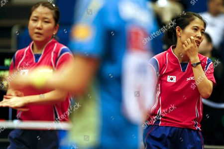 Stock Photo of Park Mi Young (l) and Kim Kyung Ah (r) of South Korea React During Their Women's Doubles Semi Final Match Against China's Ding Ning and Guo Yan at the World Table Tennis Championships in Yokohama South of Tokyo Japan 04 May 2009