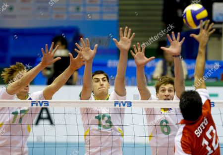 Australia's Paul Carroll (l) David Ferguson (2-l) and Igor Yudin (2-r) Try to Block the Spike by Puerto Rico's Spiker Hector Soto (r) During the 4th Round Match of the 2007 Fivb Men's World Cup Volleyball Held at Metropolitan Komazawa Olympic Park in Tokyo Japan 01 December 2007 Australia Beat Puerto Rico 3-1 (25-21 15-25 25-18 25-21)