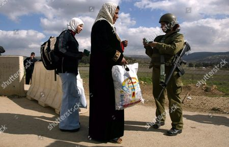 An Israeli Female Soldier Stops a Palestinian Woman For Identification at Howara Checkpoint Near the West Bank City of Nablus 12 February 2004 the European Union Said Wednesday That the Israeli Security Barrier Cutting Off the West Bank From Israel Would Hinder Mideast Peace Efforts There Was No Doubt the Wall Would Impede Progress with the Mideast Peace Plan Irish Minister For European Affairs Dick Roche Told the European Parliament in Strasbourg