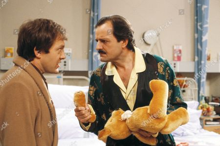 Stock Picture of 'Only When I Laugh' TV - 1982 - Norman Binns [Christopher Strauli] and Archie Glover [Peter Bowles]