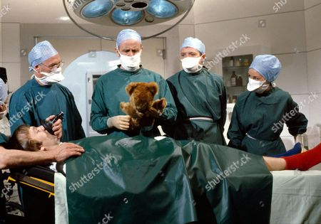 'Only When I Laugh' TV - 1979 - Dr Gordon Thorpe [Richard Wilson-with Teddy] loses control over discipline in his theatre when about to operate on Norman [Christopher Strauli], who has been persuaded onto the operating table by Figgis [James Bolam].