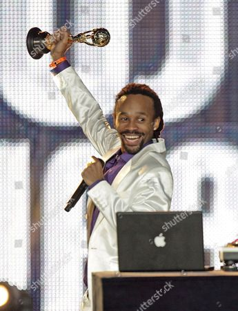 Tshawe Baqwa of Norwegian Band Madcon Holds Up His Trophy During the World Music Awards 2008 at the Monte Carlo Sporting Club in Monaco 09 November 2008